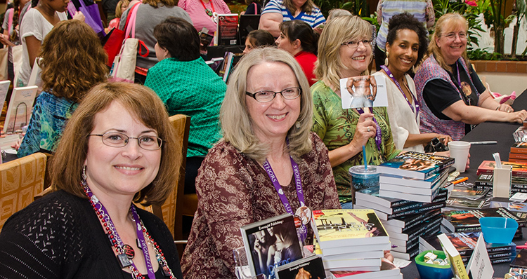 Five authors signing